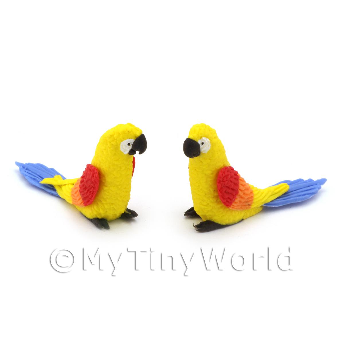 2 Yellow Dolls House Parrots with Multi-coloured Wings and Blue Tails
