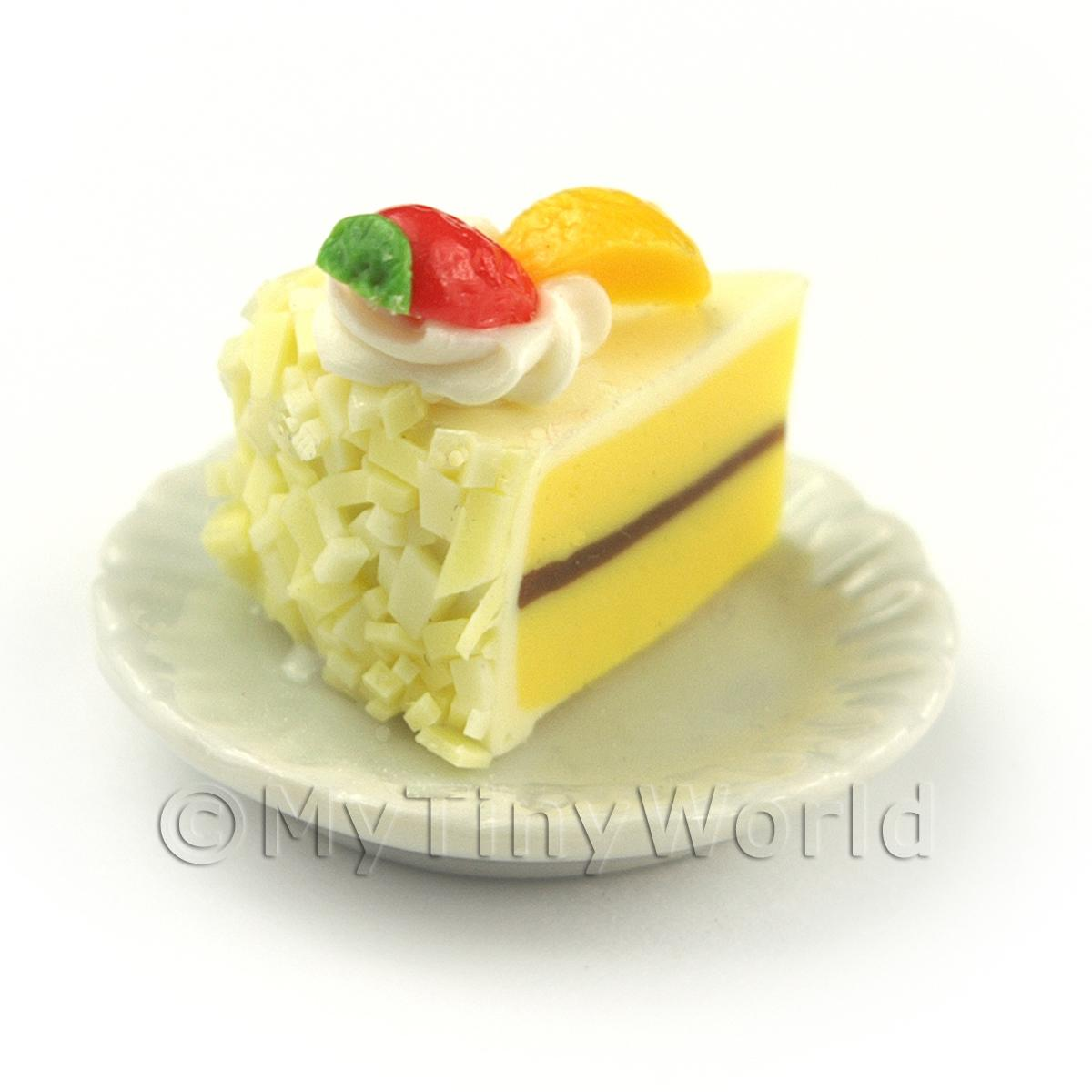 Miniature Yellow Iced Individual Strawberry and Peach Cake Slice