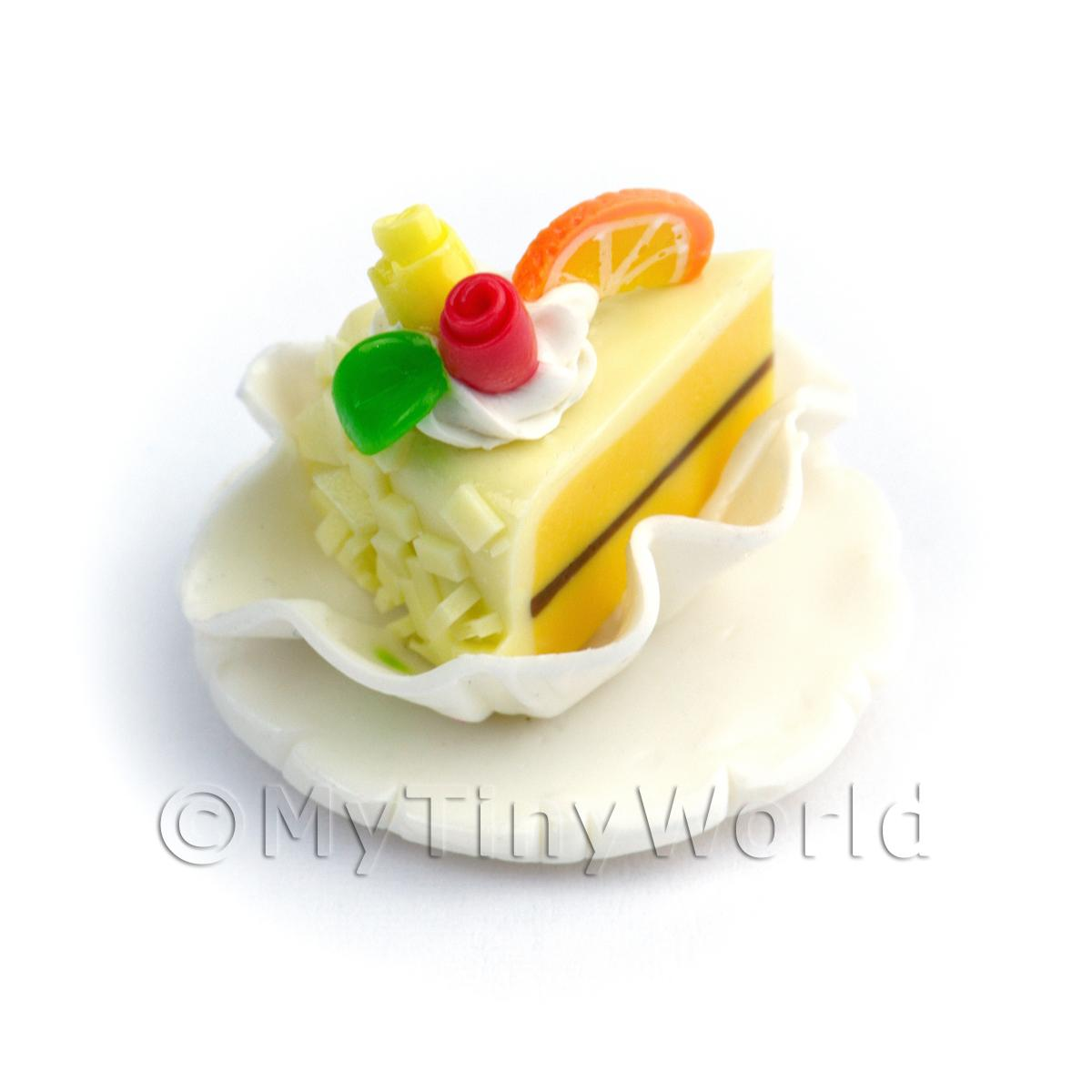 Miniature Pale Yellow Iced Individual Cake Slice On A Clay Plate