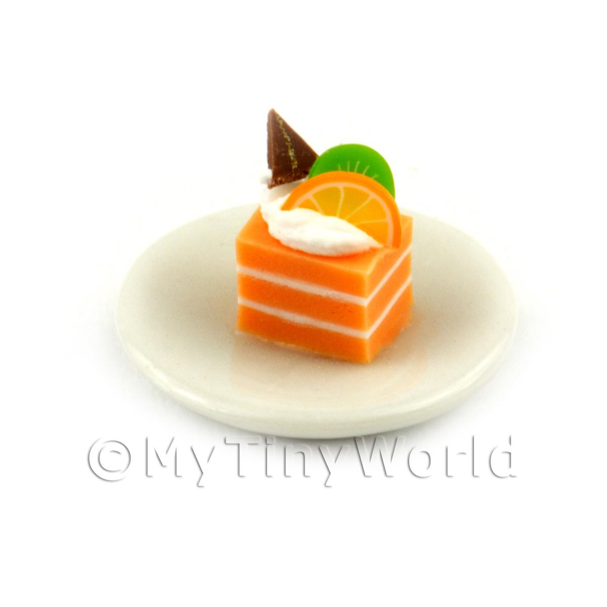 Miniature Orange And White Square Cake Slice Topped With Fruit