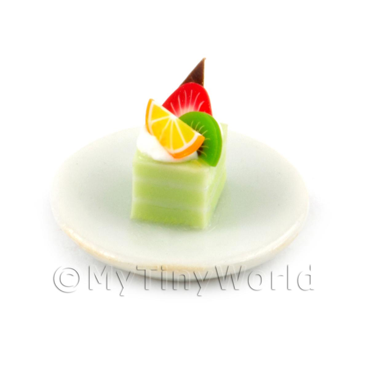 Miniature Green  And White Square Cake Slice Topped With Fruit