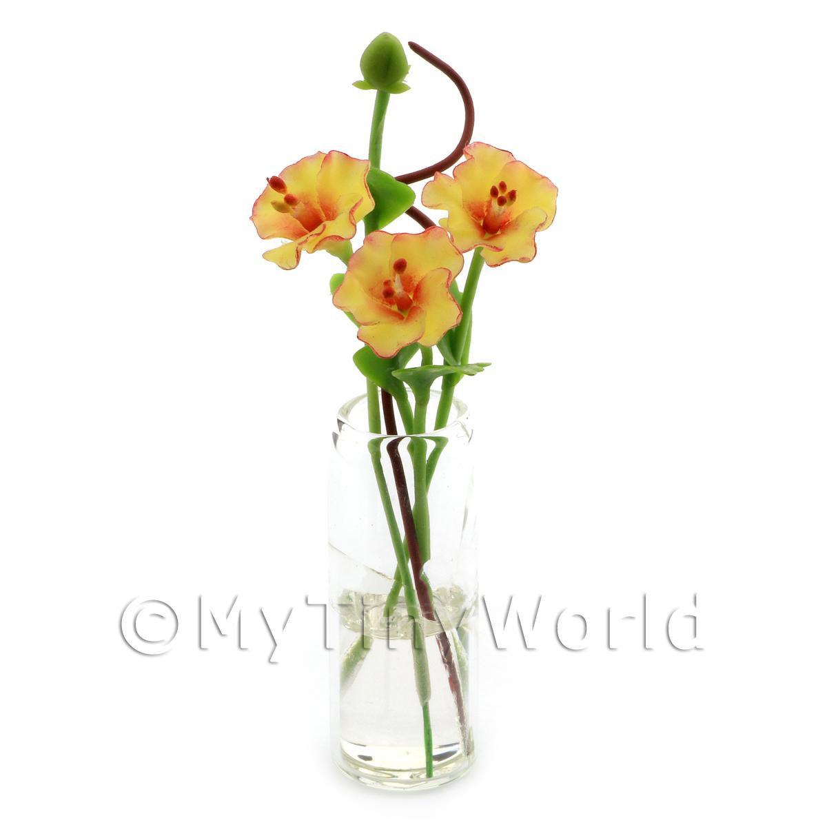 4 Miniature Yellow Cut Flowers in a Glass Vase