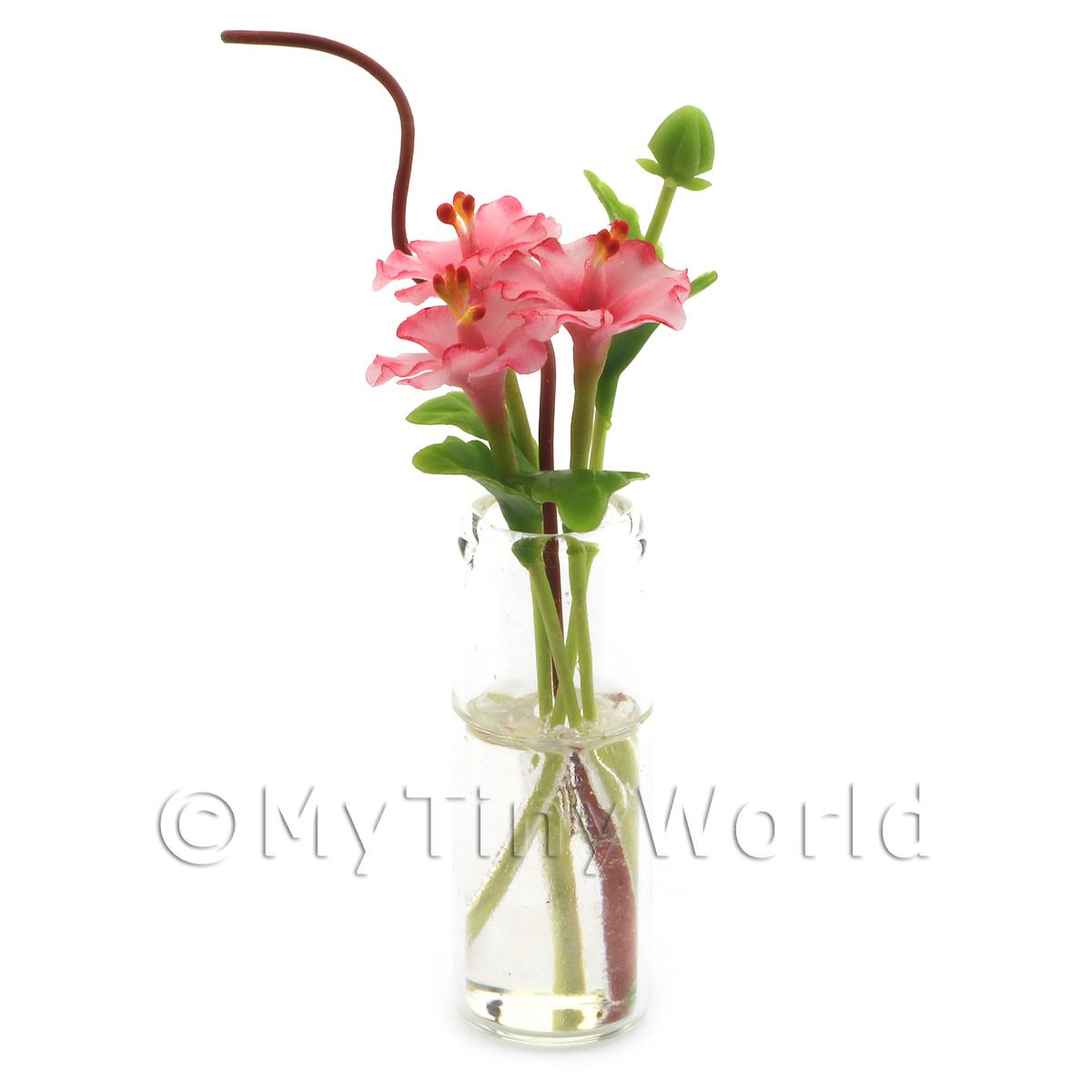 4 Miniature Pink Cut Flowers in a Glass Vase