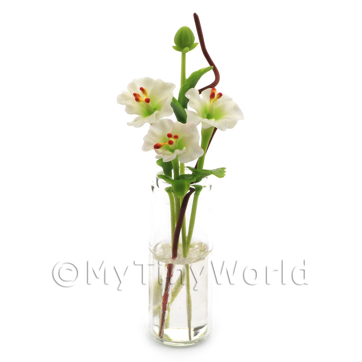 4 Miniature White Cut Flowers in a Glass Vase