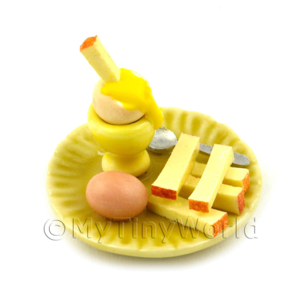 Dolls House Miniature Boiled Egg Being Dipped On A Yellow Plate