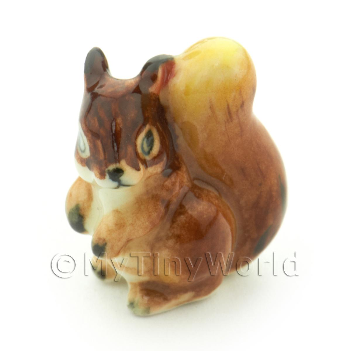 Dolls House Miniature Brown ceramic squirrel holding nut