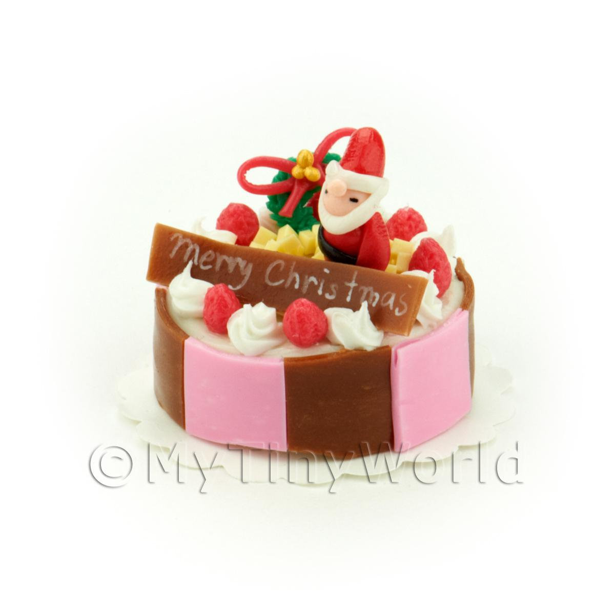 Miniature Pink and Brown Father Christmas Topped Cake