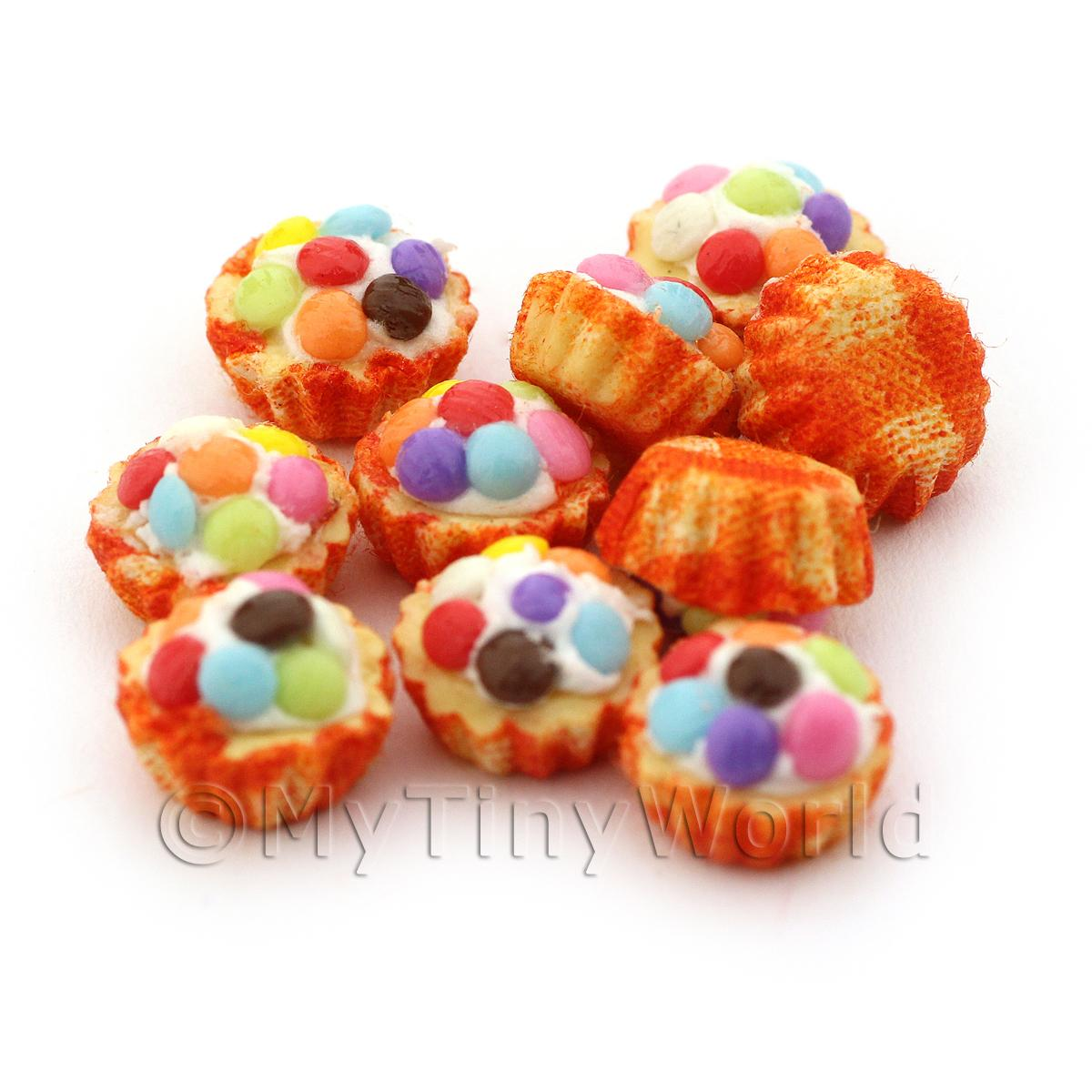 Miniature Smartie Topped Cupcake With A Orange Paper Cup