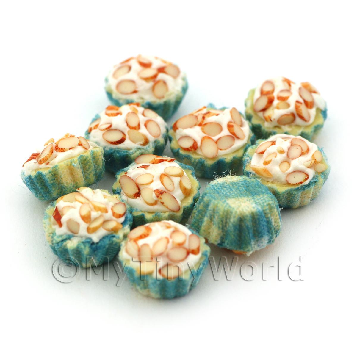 Miniature Chopped Almond Cupcake With A Blue And White Paper Cup
