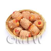 12 Miniature Cheese Coated Sausage Rolls In A Large Basket