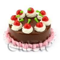 Miniature Round Cherry Topped Chocolate Cake