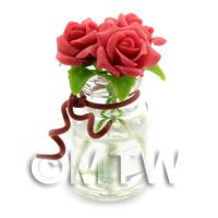 3 Miniature Dark Red Roses in a Short Glass Vase