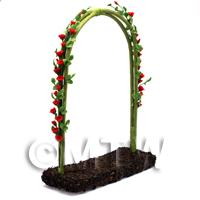 Red English Climbing Roses On A Miniature Wire Arch