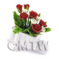 Mixed Red and White Flowers in a Miniature Wheelbarrow Planter