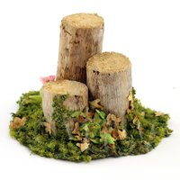 A Handmade Spring Garden Scene With Bark-less Tree Stumps
