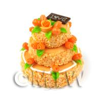 Dolls House Miniature - Orange Iced Miniature 3 Tier Celebration Cake topped with Fondant Flowers