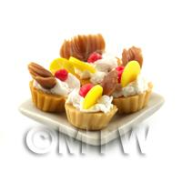 4 Dolls House Lemon Tart with A Chocolate Fan on a Plate With a Spoon