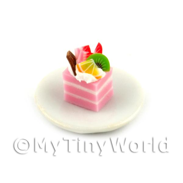 Miniature  Pink And White Square Cake Slice Topped With Fruit