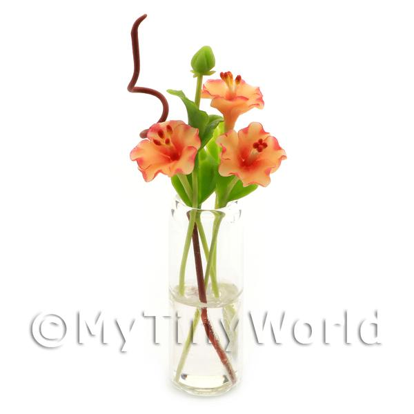 4 Miniature Orange Cut Flowers in a Glass Vase