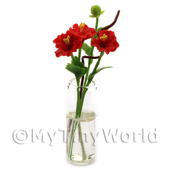 4 Miniature Red Cut Flowers in a Glass Vase