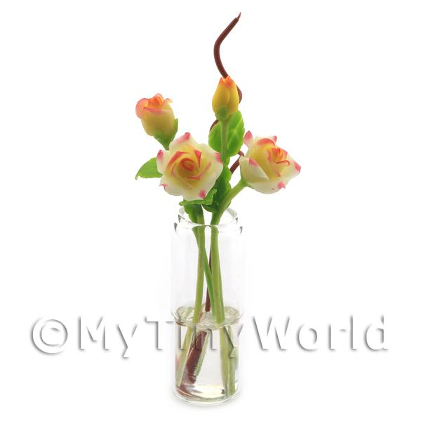 4 Miniature Long Stemmed Yellow Roses in a Glass Vase