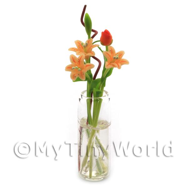 5 Miniature  Long Stemmed Orange Lilies in a Glass Vase