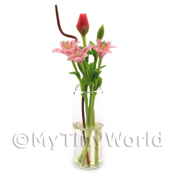 5 Miniature Long Stemmed Pink Lilies in a Glass Vase
