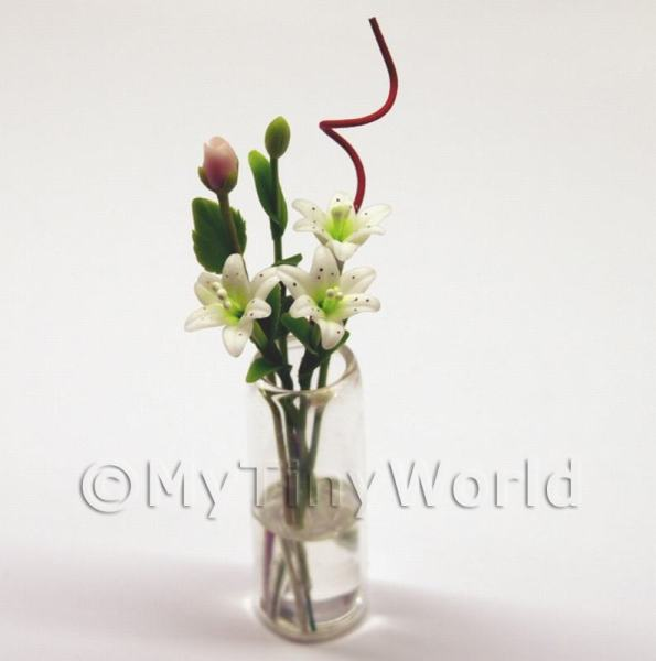 5 Miniature Long Stemmed White Lilies in a Glass Vase