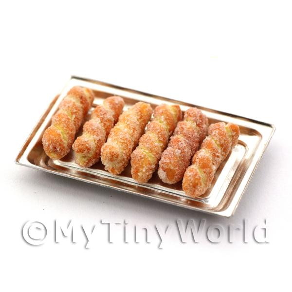Miniature Sugar Dusted Pastry Twists on an Aluminium tray