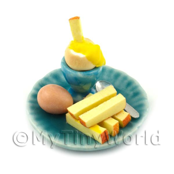 Dolls House Miniature Boiled Egg Being Dipped On A Blue Plate