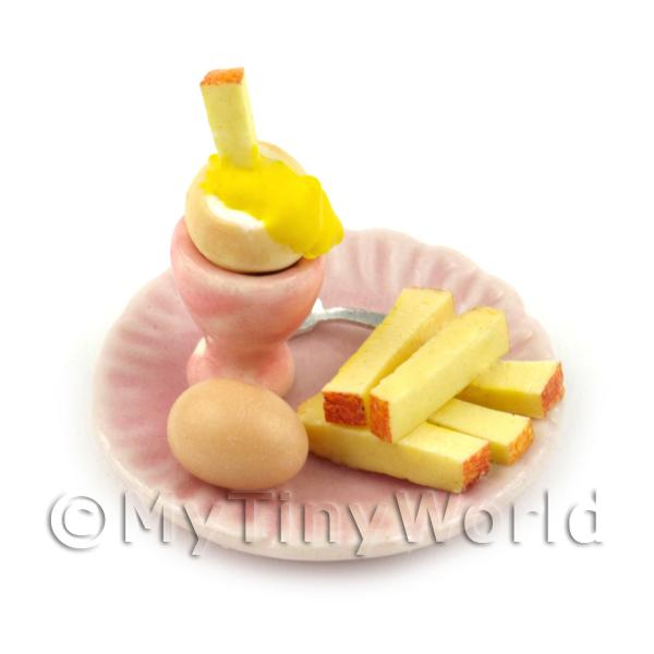 Dolls House Miniature Boiled Egg Being Dipped On A Pink Plate