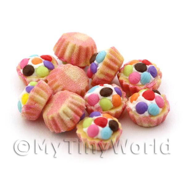 Miniature Smartie Topped Cupcake With Pink And Yellow Paper Cup