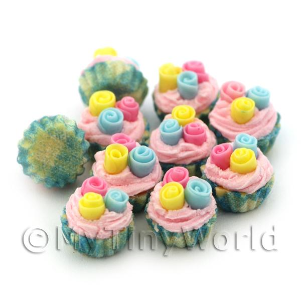 Miniature Pastel Fondant Roses Cupcake With Blue And Yellow Paper Cup