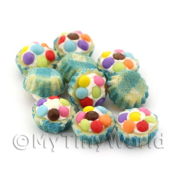 Miniature Smartie Topped Cupcake With A Blue Paper Cup