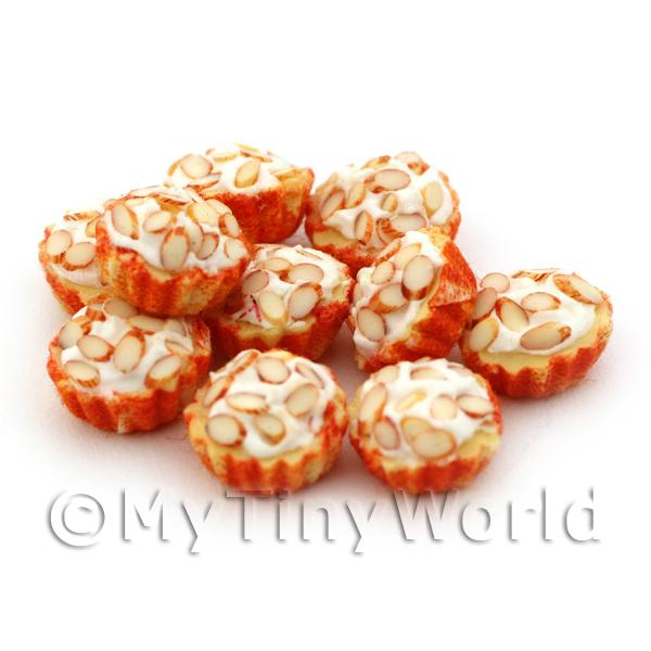 Miniature Chopped Almond Cupcake With A Orange And White Paper Cup